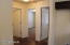 From the kitchen, we can see the full bathroom on the left and the two bedrooms on the right.