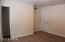Here is the view of bedroom 1 from the other side of the room. You can see the closet doors as well as the cable hookup on the wall.