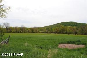 48.8 acres. Blend of fields and woodland