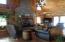 Beautiful floor to ceiling stone fireplace with heatilator wood burner