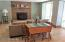 Comfortable family room with fireplace and wet bar!
