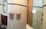 Multiple shower heads, tile walls. Love it!