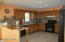Cabinets feature top rail. Kitchen features Ceramic Flooring & Beveled Counter top.