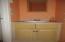 Half Bath off Kitchen,Laundry Area & Service Door & Den.