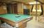 Spacious Pool table does not overwhelm the room.