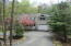 Paved Horseshoe Driveway Leads to home & garage