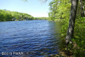 60 acres with over 500 ft. lake frontage!