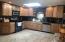 Eat In Kitchen: Granite counter tops, mosaic backsplash & tile floor