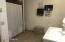 Large Full Bath with ceramic tile floor.