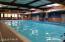 Indoor Pool features dual Saunas & is adjacent to gym.