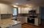 All new kitchen with granite counters & SS appliances