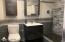 Lower level modern fully tiled bath