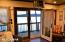 Double doors that open to large deck at big house