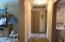 Hallway to Bedrooms with Linen Closet
