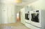 Large Mud Room/Laundry with Maytag Front Loading Washer/Dryer