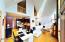 Great Room - Hardwood Floors and Floor-to-Ceiling Windows & Fireplace