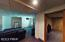 Basement Heading Towards Pool Room & Private Fitness Area