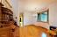 Formal Dining Room - looking towards corridor to Main Bathroom, Laundry room, and Garage