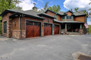 Three Car Heated Garage, Partially Heated Driveway with Built-in Work Benches and Commercial Air Compressors