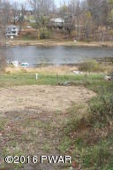 Lakefront building lot with drilled well and septic