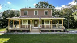 Featuring large wrap around porch