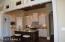 Beautiful Stained Island and Lots of Cabinetry