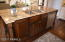 Huge Island Stained To Contrast Cabinetry