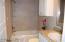 Guest Bathroom Features Custom Tile Surround