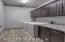 Laundry room with cabinets and countertop!