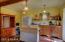 Guest cottage includes kitchen, island, fridge
