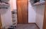 Walk-in closet leading to cedar closet