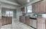 View of kitchen from garage entry hallway