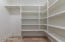 LARGE pantry with custom shelving and fridge space