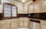 Kitchen sink area with plantation shutters