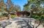 Beautifully landscaped gated entrance with entrance approval keypad