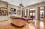 Expansive living room opens up to spacious rear patio, outdoor kitchen and pool