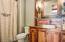 Custom built wooden cabinet with reclaimed colored wood backsplash