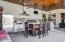 """Complete outdoor kitchen w/ 4-burner gas stove, full refrigerator, 36""""grill, griddle, boiler burner and dishwasher."""