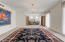 Large formal dining room/flex space has painted brick wall
