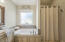 Master bathroom with separate shower and bath