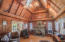 Vaulted ceilings and sky lights offer a sense of grandeur, and numerous windows fill the room with natural daylight...