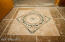 Recently installed Travertine floors add distinct appeal discerning buyers expect.