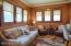 Main floor family room with leaded glass windows