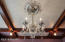 Original lighting including a silver and crystal chandelier