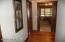 The bedroom wing has wood floors, width, and solid wood doors.