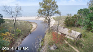 More than 330' Lake Michigan frontage, 14+ acres of undulating forested dunes, and breathtaking views and beach for as far as the eyes can see...