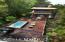 Swim-X resistance pool/hot tub on one of multiple lake/forest view decks (over 5000 square feet of Ipe, Brazilian hardwood decks)