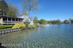 72' of Gull Lake waterfront with newer sea wall and professional landscaping