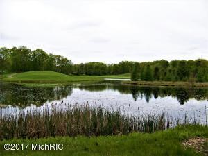Lot overlooking pond and 16th green of St. Ives Golf Club.