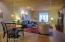Open floor plan sandblasted brick, & original butcher block ceiling